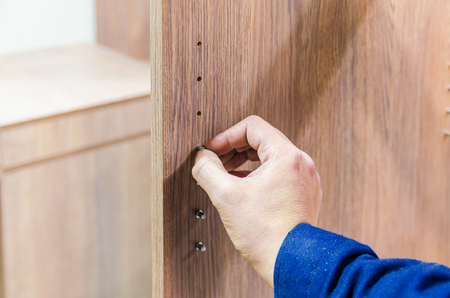 segregation: assembly of furniture and equipment Shelf panel for racial segregation shelves Stock Photo