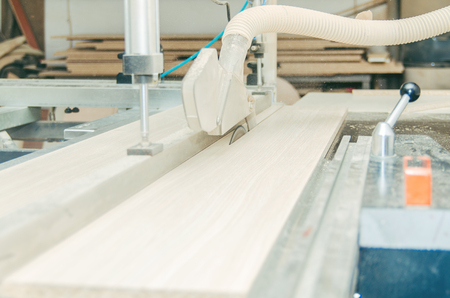 electric material: Production of cabinet furniture, sawing, materials on a format-cutting machine Stock Photo