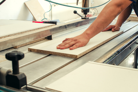 Production of cabinet furniture, sawing, materials on a format-cutting machine Stock Photo