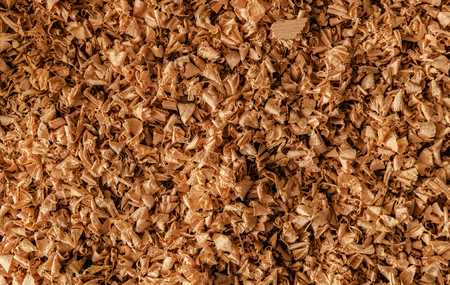Wooden sawdust from the manufacture of joinery, background of sawdust close up 스톡 콘텐츠