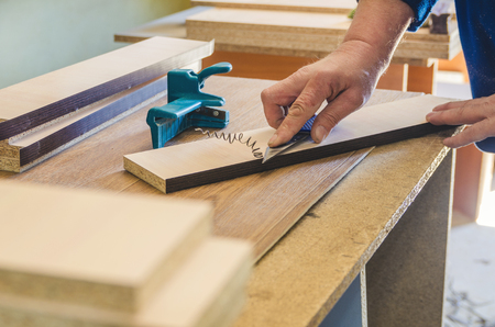 The carpenter processes the blanks for the manufacture of furniture