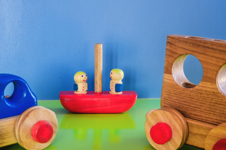 Wooden toys, typewriter with trailer and passengers 스톡 콘텐츠 - 122267013