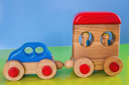 Wooden toys, typewriter with trailer and passengers 스톡 콘텐츠 - 122267018
