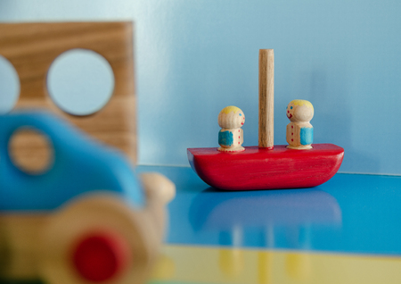 Wooden toys, typewriter with trailer and passengers 스톡 콘텐츠