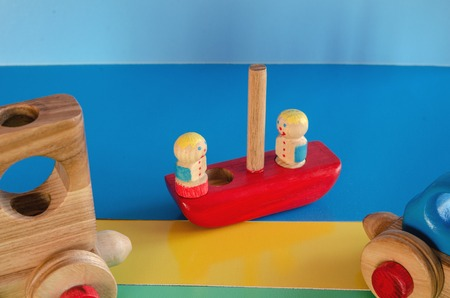 Wooden toys, typewriter with trailer and passengers. Weekend Trip 스톡 콘텐츠 - 122267079