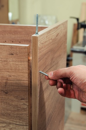 Build furniture. Furniture blanks and accessories, self-tapping screw, confirmat, close-up