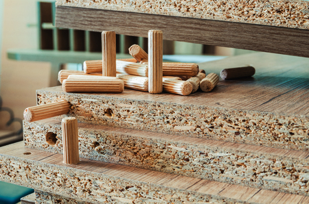 Furniture fittings, wooden dowels, fastener connection on chipboard workpieces, close-up 스톡 콘텐츠 - 123354674