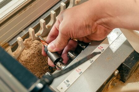 Close-up drilling machine, furniture production, drilling holes in furniture blanks 写真素材