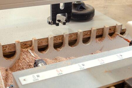 Close-up drilling machine, furniture production, drilling holes in furniture blanks close-up 스톡 콘텐츠 - 130572029