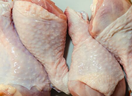 Chicken, raw drumsticks in the kitchen, cooking close-up Stockfoto