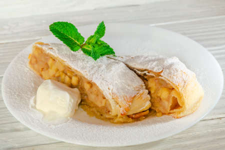 Hot fruit strudel with apple spices and a slice of butter