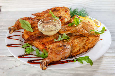 baked grilled chicken with garlic sauce, herbs and lemon