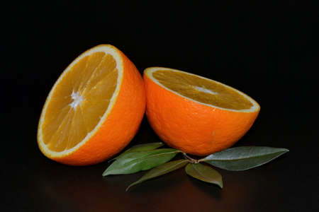Oranges fruits on a black background, isolated