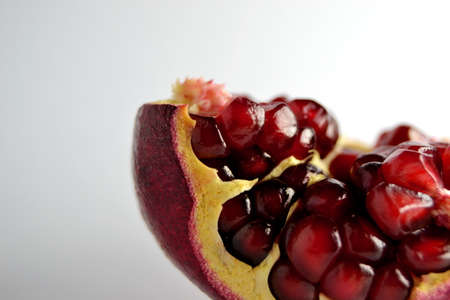 half of pomegranate isolated on a white background, close up