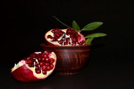 pomegranate fruit on black background