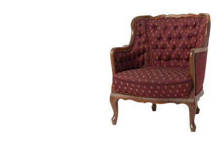 Royal red textile armchair in a classic style. Retro. Antiques. Isolate.