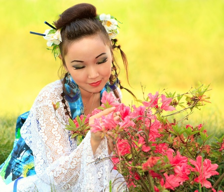 The Japanese sitting about pink colours on a meadow photo