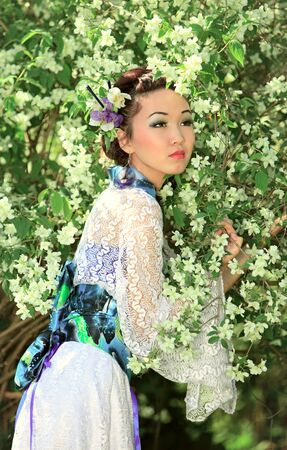 The Japanese in a kimono costs in white colours photo