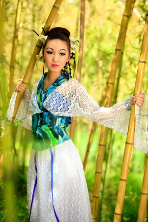 The Japanese in a kimono costs in bamboo wood photo