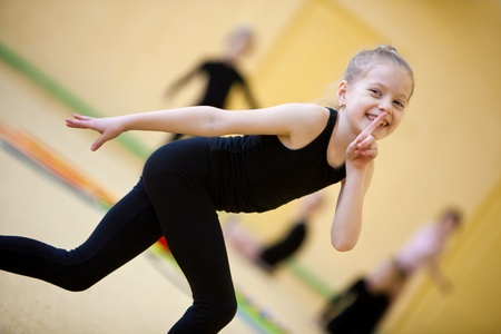 female gymnast: young gymnast doing exercise Stock Photo