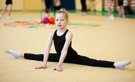 balance beam: young gymnast doing exercise Stock Photo