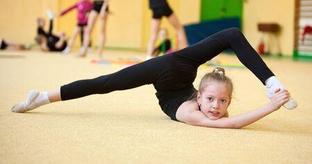 balance beam: young gymnast doing exercise Stock Photo