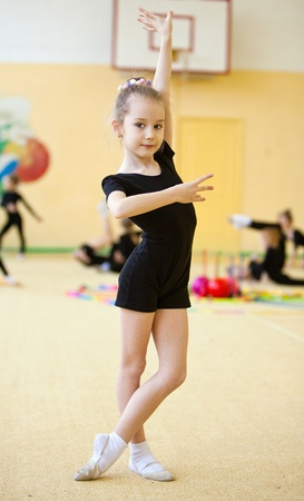 young gymnast doing exercise photo