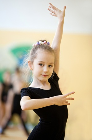 young gymnast doing exercise Standard-Bild