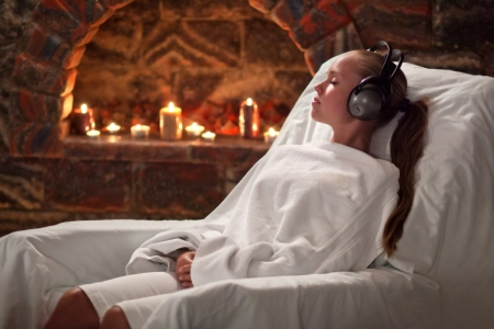 girl receives treatment in a sanatorium by the inhalation of salt caves and listening to music photo