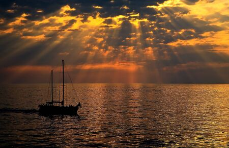 Sailboat sailing at sunset - dream photo