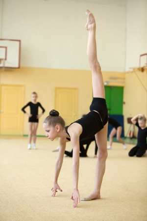 young gymnast stretching and training photo
