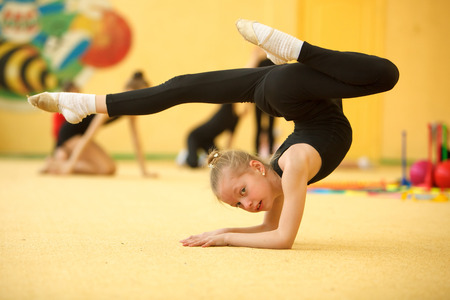 Childrens in sports-young gymnast train your body