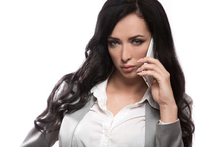 girl on white background in classic clothes with phone Standard-Bild