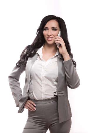 Business woman on the white background in classic clothes