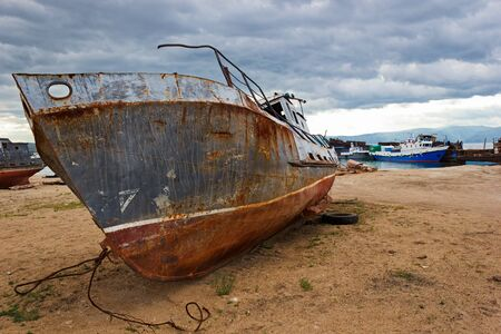 old ship: The old ship lays on lakeshore Baikal about settlement Huzhir on island Olkhon