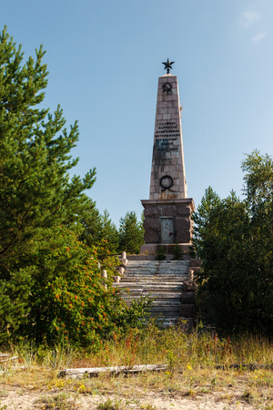 Monument to the communists who have been stirred up by interventionists in camp in 1918 - 1920 on island Mudjug in a river mouth Northern Dvina, Russia.