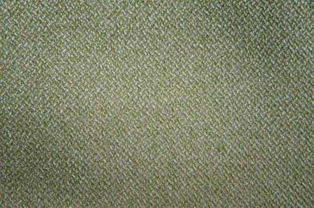 Rough olive canvas texture. Texture of natural linen fabric. Abstract backdrop.