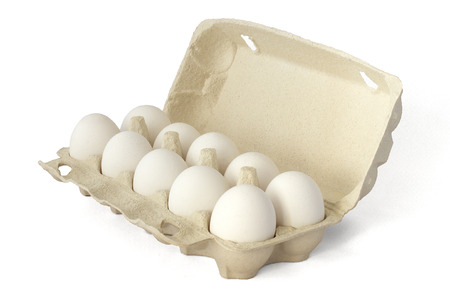 A dozen selected eggs in a standard box for sale in the store