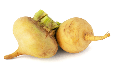 Fruit fresh turnip with stems and green leaves on a white background