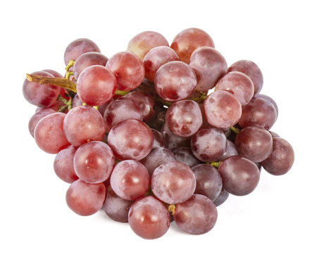 A bunch of ripe juicy red grapes covered with a matte light film