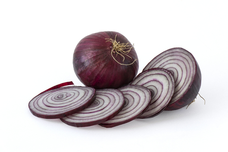 Red onion with rings cut by half other on white background Foto de archivo