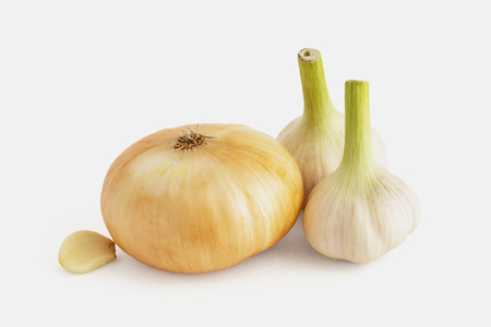 Pot-bellied kind bulb with two heads and a clove of garlic on a white background