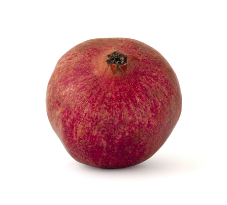 Juicy ripe pomegranate fruit not peeled with watery seeds inside bright pomegranate color