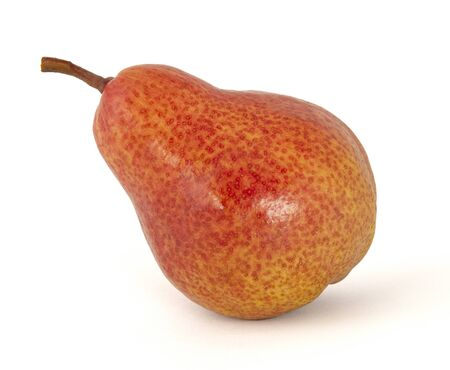 Ripe fragrant pear yellow covered with large bright red cute specks with a tilt to the left on a white background Фото со стока