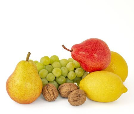Appetizing fragrant red pears lemon in a fruit platter of ripe green grapes and walnuts on a white background
