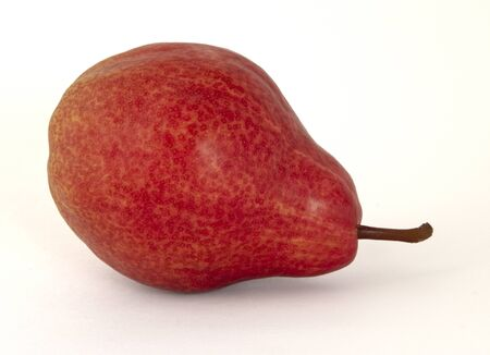 Ripe fragrant pear yellow covered with large bright red cute specks on a white background 版權商用圖片