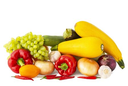 Large set of vegetables of pink tomato Bulgarian and chili peppers grape branches red onion garlic zucchini and eggplant on a white background