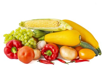 Big set of vegetables rose tomato corn cob Bulgarian and Chile pepper sprig of grapes onions garlic zucchini and eggplant on white background Stok Fotoğraf