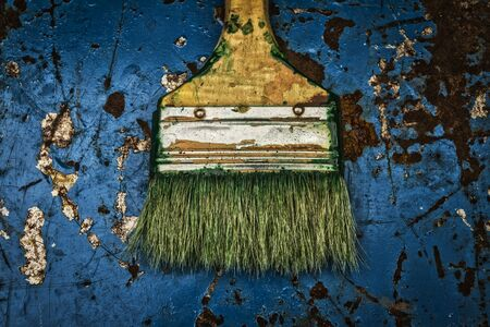 bristles: paint brush and a rusty iron,brush on metal Stock Photo