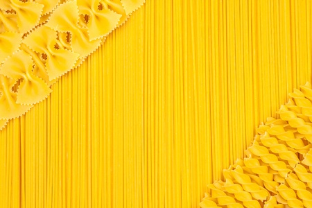 Set of raw pasta and spaghetti as background photo